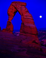 Moonrise at Delicate Arch, Arches National Park, Utah   Large free-standing natural arch in Entrada sandstone. Lit by summer sunset glow.