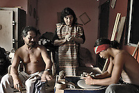 """Oct, 2007, Easter Island, Chile....German Icka Pakarati,  best known as """"Cacho"""" (47) . Fischerman, sculptor, singer and musician. He was born on Easter Island in 1960. CAcho with his wife Viki and his son Tanga Roa. They are teching how work with ceramic. After 5 days as a tourist, photographer Lorenzo Moscia set to discover the real life of one of the more surprising places of the World, mix of cultures between Oceania and Latin America, with a native population near extintion./"""