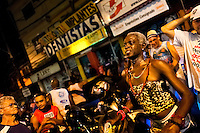 A Brazilian transvestite performs during the Carnival parade in the favela of Rocinha, Rio de Janeiro, Brazil, 20 February 2012. Rocinha, the largest shanty town in Brazil and one of the most developed in Latin America, has its own samba school called GRES Academicos da Rocinha. The Rocinha samba school is very loyal to its neighborhood. Throughout the year, the entire community actively participate in rehearsals, culture events and parades related to the carnival.
