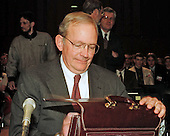 Central Intelligence Agency (CIA) Director-designate Anthony Lake opens his briefcase in preparation for his days testimony before the United States Senate Intelligence Committee on his nomination on Capitol Hill in Washington, DC on March 12, 1997.<br /> Credit: Ron Sachs / CNP