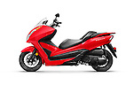 Red 2014 Honda Forza ABS motor scooter isolated on white background with clipping path