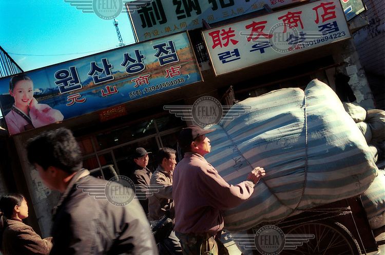 North Korean traders shop for daily neccessities to take back to North Korea..Dandong is on one side of the Yalu River, which marks the border between China and North Korea.
