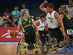 Patrick Anderson (12) of Vancouver defends against Shaun Norris of Australia in the gold medal game in men's wheelchair basketball action in Beijing during the Paralympic Games, Tuesday, Sept., 16, 2008.   Photo by Mike Ridewood/CPC