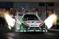 Sept. 17, 2010; Concord, NC, USA; NHRA funny car driver Ashley Force Hood launches off the starting line during qualifying for the O'Reilly Auto Parts NHRA Nationals at zMax Dragway. Mandatory Credit: Mark J. Rebilas/