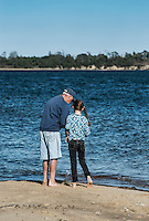 Man teaching his granddaughter to fish, Mill Pond, Orleans, Cape Cod,