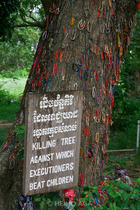 Phnom Penh, Cambodia. Choeung Ek Killing Fields memorial site, a reminder of the genocide committed by the Khmer Rouge. The Killing Tree was used to kill little children.