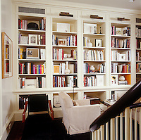 A library area with a custom-made bookcase has been arranged to make clever use of this landing