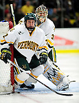 24 November 2009: University of Vermont Catamount defenseman Josh Burrows, a Junior from Prairie Grove, IL, helps defend his goal during a game against the University of Massachusetts Minutemen at Gutterson Fieldhouse in Burlington, Vermont. The Minutemen defeated the Catamounts 6-2. Mandatory Credit: Ed Wolfstein Photo