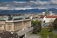 Switzerland. Geneva. Old town. View on the Musée d'Art et d'Histoire (Museum of Art and History) (L), the St. Pierre Cathedral (R) and the Jura mountains with snow on top. The Musée d'Art et d'Histoire (Museum of Art and History) is the largest art museum. It was built by the architect Marc Camoletti between 1903 and 1910, and financed by a bequest from the banker Charles Galland (1816–1901). The building is square, with 60 m sides surrounding an inner courtyard. It has four storeys, with roof lanterns on the top floor, and a total exhibition space of 7,000 m². The façade is decorated with sculptures by Paul Amlehn.  The St. Pierre Cathedral is a cathedral which belongs to the Reformed Protestant Church of Geneva. It is known as the adopted home church of John Calvin, one of the leaders of the Protestant Reformation. 25.04.2016 © 2016 Didier Ruef