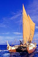 Polynesian voyaging canoe Hokulea in open ocean off the island of Molokai
