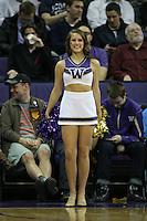 December 22, 2013:  Washington cheerleader Rachel Huschka entertained fans during a timeout against Connecticut.  Connecticut defeated Washington 82-70 at Alaska Airlines Arena Seattle, Washington.