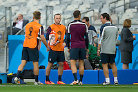 Wayne Rooney of England talks to team mates during training