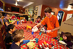 Preston Larson, one of Happie and Rich Larson's foster children, pours his siblings a glass of milk at their Layton home, Wednesday, Dec. 26, 2012. Rising milk prices will have a severe effect on the Larsons who often go through two gallons of milk per day