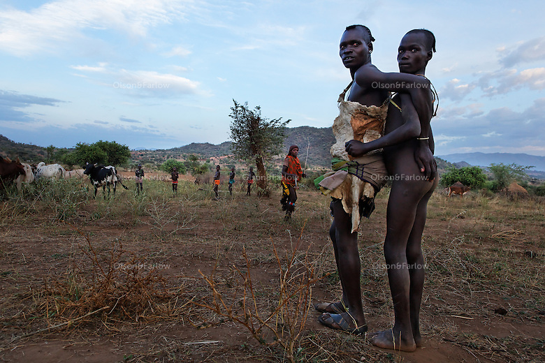 """Bene tribe Bull Jumping Ceremony.  The kid doing the bull jumping is Gaito Loka and it is a coming of age ceremony for the Hamar and Bene tribes.  Woman that are related to the boy get whipped in support of him.  The idea is that at some point if they need help they can go to him and say """"look... I was there to support you at your bull jumping, SEE THE SCARS... now I need your help.""""..Bull jumpings also have a lot of dancing and activity so they have become local tourist attractions... even this one that is so remote.  The CAMERA CLUB group with tripods is all a separate trip put on by Steve Turner...Contacts:.Steve Turner... steveturner@originsafari.info.+ 254 722 707521..Robel Pedros Local guide for Surma.+ 251 911 423112.Daniel Tesfaye  +251 912 029726"""