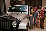 An Iraqi family shops for the latest models of imported American cars and trucks at a recently opened Dodge/Jeep/Chrysler dealership in the Karrada district of Baghdad August 23, 2010. Iraqis have developed a healthy appetite for newly available consumer goods including cars, satellite dishes and cel phones over the past several years.  .