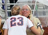 March 06, 2011 - Charlottesville, Virginia, USA -  SHARON DONNELLY, the mother of slain Virginia women's lacrosse player Yeardley Love, receives a hug from Virginia women's lacrosse Marghi Walters (23) during a ceremony permanently retiring the number one jersey worn by Yeardley Love Sunday at Klockner Stadium. Love's body was found May 3, 2010 and Virginia men's lacrosse player George Huguely is charged with murder. (Credit Image: © Andrew Shurtleff)