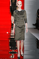 Louisa walks runway in a ebony metallic herringbone fitted sheath dress with beaded sleeves, from the Reem Acra Fall 2012 Feminine Power collection fashion show, during Mercedes-Benz Fashion Week New York Fall 2012 at Lincoln Center.