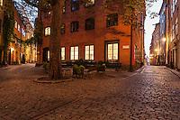 Cafe on narrow cobble stone street, Gamla Stan, Stockholm, Sweden