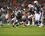 Auburn running back Michael Dyer (5) is tackled by Ole Miss' Cameron Whigham (55) at Jordan-Hare Stadium in Auburn, Ala. on Saturday, October 29, 2011. .