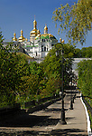 Travel stock photo of a View on Mother of God Assumption church golden cupola from the road to the far caves on the territory of Kievo-pecherskaya lavra - Kiev pechersk lavra - Cave monastery in Kiev Ukraine Eastern Europe Architecture in Ukrainian baroque architectural style Largest monastery in Russia Vertical orientation May 2007
