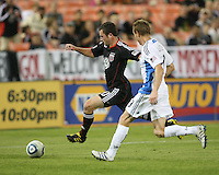 Stephen King #20 of D.C. United races away from Christopher Leitch #3 of the San Jose Earthquakes during an MLS match at RFK Stadium in Washington D.C. on October 9 2010. San Jose won 2-0.