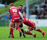 Guy Mercer of Bath Rugby is double-tackled. Pre-season friendly match, between the Scarlets and Bath Rugby on August 20, 2016 at Eirias Park in Colwyn Bay, Wales. Photo by: Patrick Khachfe / Onside Images