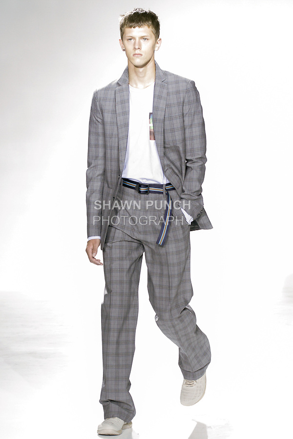 """Model walks runway in an outfit from the Richard Chai Mens Spring 2016 """"Pet Shop Boys"""" collection runway show, during New York Fashion Week Men's Spring Summer 2016."""