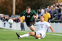 Colin Skelly (22) of the Dartmouth Big Green goes flying over the tackle by Anthony Vazquez (5) of the Monmouth Hawks. Dartmouth defeated Monmouth 4-0 during the first round of the 2010 NCAA Division 1 Men's Soccer Championship on the Great Lawn of Monmouth University in West Long Branch, NJ, on November 18, 2010.
