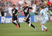 Kurt Morsink #6 of D.C. United moves past Wells Thompson #15 of the Colorado Rapids during an MLS match on May 15 2010, at RFK Stadium in Washington D.C. Colorado won 1-0.