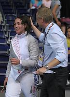 European Championships Fencing 2010 / Fecht Europameisterschaft 2010 in Leipzig - Competition Championat d'europe - im Bild: Sibylle Klemm (GER, Women Sabre / Damen Säbel ) after winning her match in quart finale with DFB press responsible Sven Ressels. Foto: Norman Rembarz..Norman Rembarz , Autorennummer 41043728 , Augustenstr. 2, 04317 Leipzig, Tel.: 01794887569, Hypovereinsbank: BLZ: 86020086, KN: 357889472, St.Nr.: 231/261/06432 - Jegliche kommerzielle Nutzung ist honorar- und mehrwertsteuerpflichtig! Persönlichkeitsrechte sind zu wahren. Es wird keine Haftung übernommen bei Verletzung von Rechten Dritter. Autoren-Nennung gem. §13 UrhGes. wird verlangt. Weitergabe an Dritte nur nach  vorheriger Absprache..