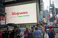 The Walgreens drug store at One Times Square in New York is seen on Saturday, April 22, 2017. The Federal Trade Commission is considering fling a lawsuit to block the Walgreens Boots Alliance-Rite Aid acquisition.  (© Richard B. Levine)
