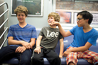 Lucas, Felix and Alan on the subway. New York summer holiday with family, 2014