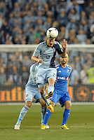 Oriol Rosell (20) midfield Sporting KC wins the header..Sporting Kansas City defeated Montreal Impact 2-0 at Sporting Park, Kansas City, Kansas.
