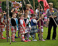 Young girls prepare to take part in a Highland dancing competition at the Inveraray Highland Games, held at Inveraray Castle in Argyll.