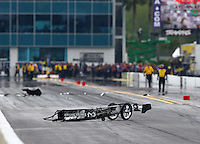 Mar 14, 2015; Gainesville, FL, USA; The front half of the dragster of NHRA top fuel driver Larry Dixon sits on the track after his car broke in half and crashed during qualifying for the Gatornationals at Auto Plus Raceway at Gainesville. Dixon walked away from the incident. Mandatory Credit: Mark J. Rebilas-
