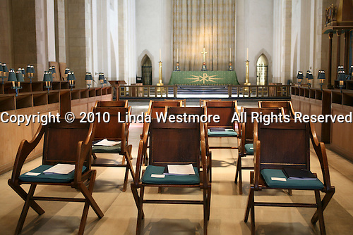 Chairs at Guildford Cathedral.  The High Altar behind.