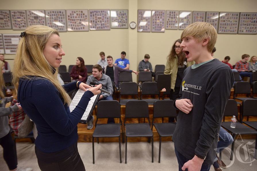 NWA Democrat-Gazette/BEN GOFF @NWABENGOFF<br /> Natasha Paremski, a pianist from New York, autographs a piece of sheet music for James Bouwhuis, a sophomore who studies piano, on Friday Jan. 27, 2017 after Paremski performed several pieces and took questions from music students at Bentonville High School. The event was part of Symphony of Northwest Arkansas's ongoing community educational outreach. Paremski is in Northwest Arkansas to perform with the symphony at their Masterworks I: 'Momentum' concert at 7:30pm on Saturday at the Walton Arts Center in Fayetteville. Paremski was born in Moscow, Russia and began studying piano at age 4 before moving the United States and becoming a citizen at age 8.