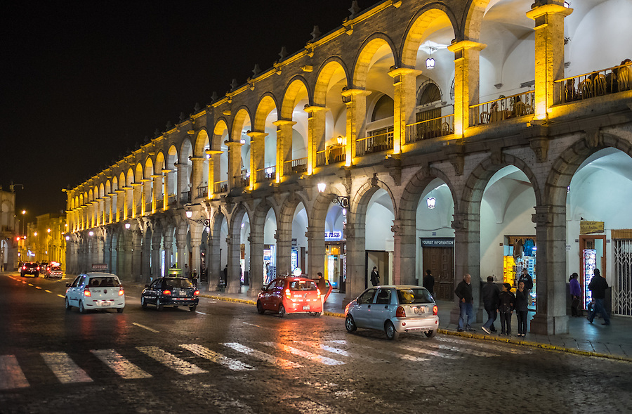 AREQUIPA, PERU - CIRCA APRIL 2014: View of typical colonnade buildings around the main square, Plaza de Armas, at night in Arequipa. Arequipa is the Second city of Perú by population with 861,145 inhabitants and is the second most industrialized and commercial city of Peru.