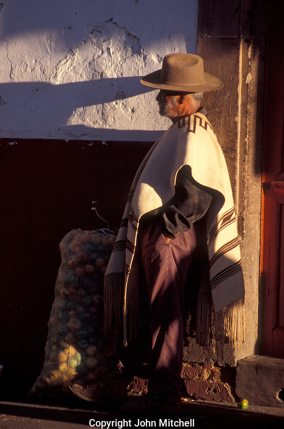 Man wearing a traditional mexican poncho  in the Spanish colonial town of Patzcuaro, Michoacan, Mexico