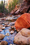 A red boulder rests in the north fork of Oak Creek Canyon near Sedona, Arizona.