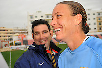 Abby Wambach enjoys a moment with the media after notching two goals vs. Norway.  The USA defeated Norway 2-1 at Olhao Stadium on February 26, 2010 at the Algarve Cup.