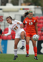COLLEGE PARK, MD - OCTOBER 28, 2012:  Aubrey Baker (3) of the University of Maryland tackles Erin McGovern (13) of Miami during an ACC  women's tournament 1st. round match at Ludwig Field in College Park, MD. on October 28. Maryland won 2-1 on a golden goal in extra time.