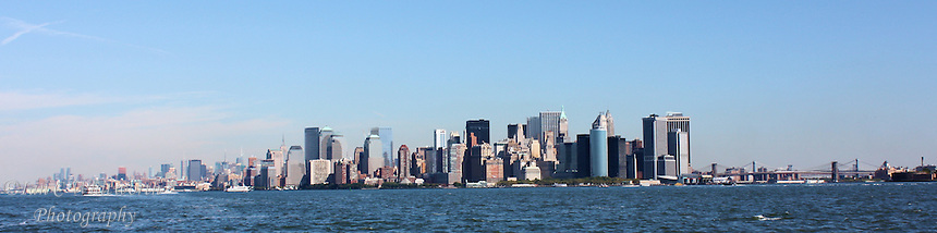 Panoramic view of the New York City skyline from the water south of Manhattan