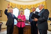 Vice President Mike Pence (R) swears in Attorney General Jeff Sessions (L) while Sessions' wife, Mary Blackshear Sessions (C-L) and U.S. President Donald J. Trump (C-R), look on in the Oval Office of the White House in Washington, DC, USA, 09 February 2017. On 08 February, after a contentious battle on party lines, the Senate voted to confirm Sessions as attorney general.<br /> Credit: Jim LoScalzo / Pool via CNP