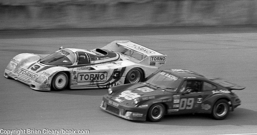 The #3 Porsche 962 of  Oscar Larrauri, Gianfranco Brancatell, and  Massimo Sigala races past the #09 Porsche 911 Carerra of Kyle Rathbun ,  John Hayes-Harlow, Larry Figaro, and Peter Uria  during the Rolex 24 at Daytona, Daytona International Speedway, Daytona Beach, FL, February 1, 1987.  (Photo by Brian Cleary/www.bcpix.com)