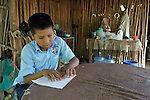 Eleven-year old Juan Lopez reads his homework - in Braille - at his home in Zipolite, a town in Oaxaca, Mexico. Juan is blind, and yet refuses to be sidelined. He rides his bike, for example, with his sister's help. She perches on the back and signals him which way to steer by pinching his shoulder. If she pinches his right shoulder, for example, he goes right. The harder the pinch, the sharper the turn.