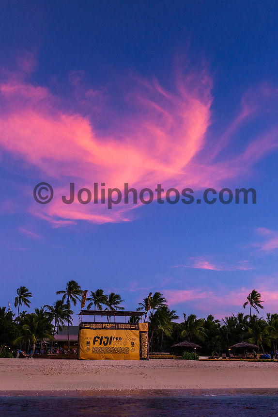 Namotu Island Resort, Namotu, Fiji. (Saturday May 24, 2014) Sunset over the back up site on Tavarua Is – The Opening Ceremony of the Women's Fiji Pro was held this afternoon on Tavarua Is. The Fiji Women's Pro, Stop No. 5 of 10 on the 2014  Women's World Championship Tour (WCT), has attracted the world's best female surfers to the world-class waves of Cloudbreak and Restaurants for the recommencement of this season's battle for the world surfing crown. Photo: joliphotos.com