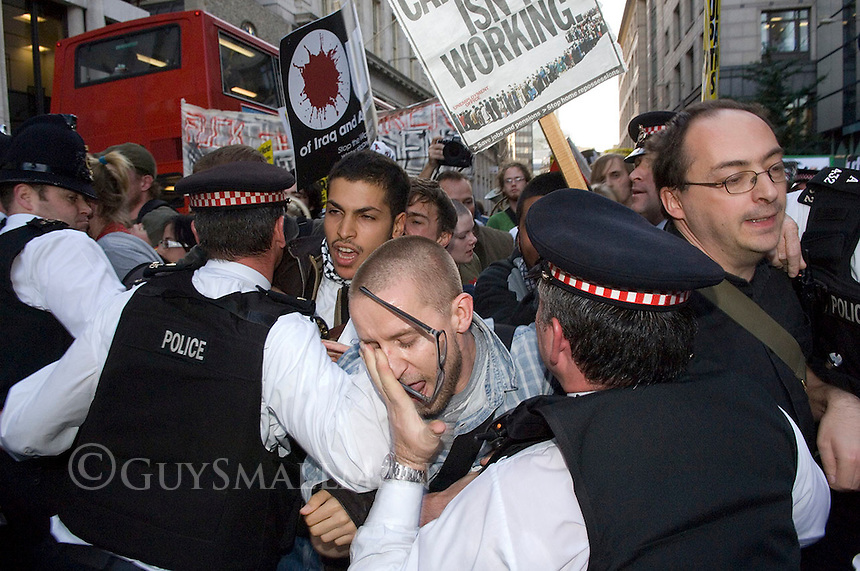 Anti Capitalists hold a demonstration in the City of London over the recent share collapse and financial crisis. There were scuffles with Police when some protesters entered the bank of England and argues with City Workers. The Scuffles then continued in the streets outside and the Police tried to contain the demonstrators.