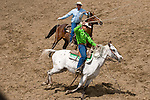 Cowboys swing their lassos ready to rope at the Jordan Valley Big Loop Rodeo, Ore..