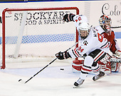 Tyler McNeely (Northeastern - 94) celebrates Jamie Oleksiak's (Northeastern - 6) first college goal. - The visiting Rensselaer Polytechnic Institute Engineers tied their host, the Northeastern University Huskies, 2-2 (OT) on Friday, October 15, 2010, at Matthews Arena in Boston, MA.